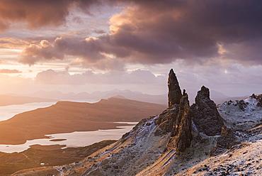 Beautiful sunrise over a snow dusted Old Man of Storr, Isle of Skye, Inner Hebrides, Scotland, United Kingdom, Europe