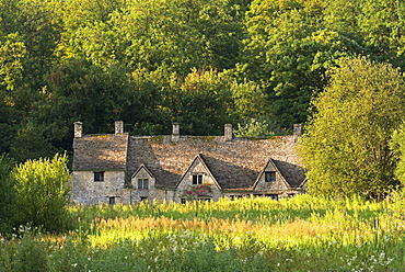 Arlington Row cottages in the Cotswold village of Bibury, Gloucestershire, England, United Kingdom, Europe