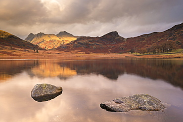 Early morning sunshine on the Langdale Pikes, reflected in Blea Tarn, Lake District, Cumbria, England, United Kingdom, Europe