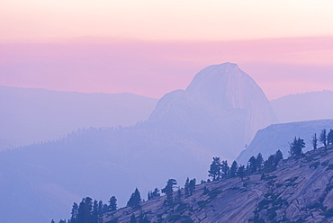 Half Dome at sunset, the mountain partially obscurred by smoke from the 2014 Dog Rock wildfire, Yosemite National Park, UNESCO World Heritage Site, California, United States of America, North America