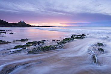 Sunrise over Mumbles Lighthouse from Bracelet Bay in winter, Swansea, Wales, United Kingdom, Europe