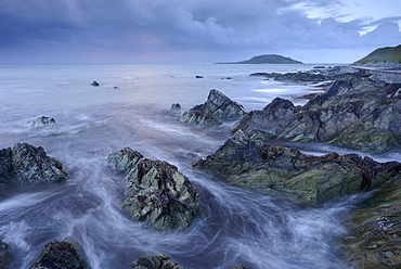 Waves swirl around Hannafore Beach at high tide, Looe, Cornwall, England, United Kingdom, Europe