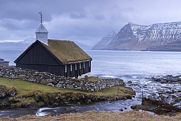 Grass roofed Church in the village of Funningur in winter on the island of Eysturoy, Faroe Islands, Denmark, Europe