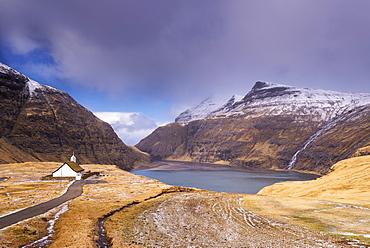 Idyllic grass roofed church in picturesque Saksun, Streymoy, Faroe Islands, Denmark, Europe