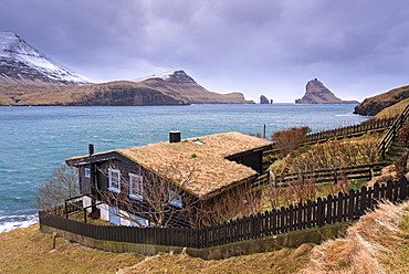 Grass roofed house in the village of Bour on the island of Vagar, Faroe Islands, Denmark, Europe