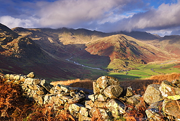 Tumbledown dry stone wall near Great Langdale in autumn in the Lake District National Park, Cumbria, England, United Kingdom, Europe