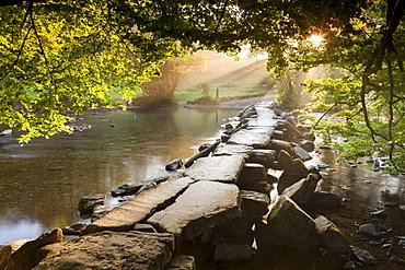 Tarr Steps clapper bridge crossing the River Barle, Exmoor National Park, Somerset, England, United Kingdom, Europe
