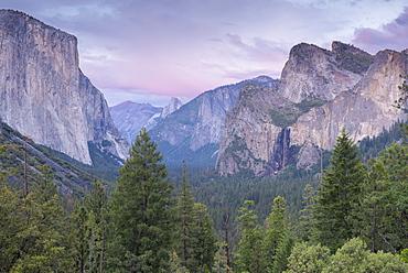 Yosemite Valley beneath pink twilight skies, Yosemite National Park, UNESCO World Heritage Site, California, United States of America, North America