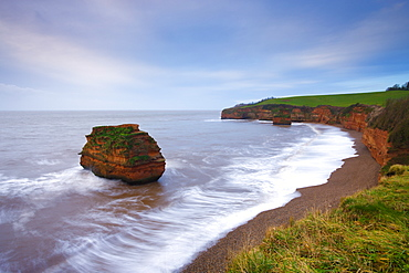 Otterton sandstone cliffs and seastacks at Ladram Bay, South Devon, England, United Kingdom, Europe