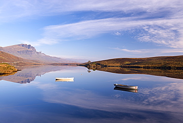 Rowing boats on Loch Fada, with the Old Man of Storr beyond, Isle of Skye, Inner Hebrides, Scotland, United Kingdom, Europe
