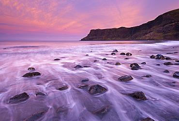 Colourful pink sunrise above Talisker Bay, Isle of Skye, Inner Hebrides, Scotland, United Kingdom, Europe