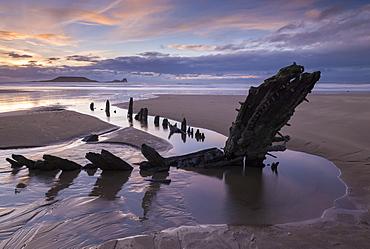 The shipwreck of the Helvetia, on Rhossili Bay, Gower Peninsula, Wales, United Kingdom, Europe