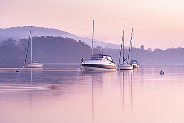 Boats moored on Lake Windermere at sunset, Bowness, Lake District National Park, Cumbria, England, United Kingdom, Europe