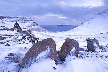 Snow covered Streymoy mountain landscape looking towards the island of Koltur, Streymoy, Faroe Islands, Denmark, Europe
