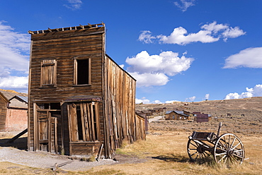 Abandoned wooden house and wagon in Bodie Ghost Town, California, United States of America, North America