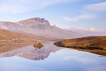 The Storr reflected in the tranquil water of Loch Fada, Isle of Skye, Inner Hebrides, Scotland, United Kingdom, Europe
