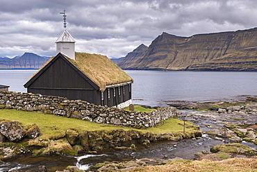 Traditional grass roofed Faroese church in the village of Funningur on the island of Eysturoy, Faroe Islands, Denmark, Europe