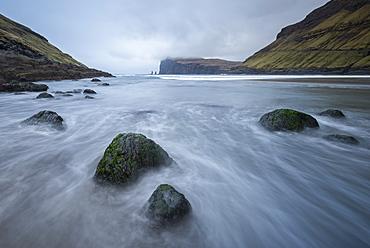 Risin and Kellingin sea stacks viewed from the shores of Tjornuvik on the island of Streymoy, Faroe Islands, Denmark, Europe
