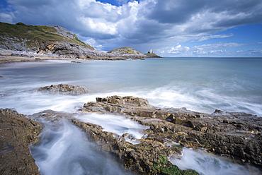 Mumbles lighthouse from Bracelet Bay, Gower Peninsula, Swansea, Wales, United Kingdom, Europe