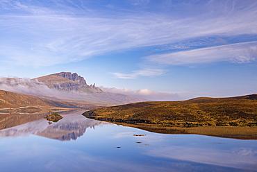 The Old Man of Storr reflected in a mirror still Loch Fada, Isle of Skye, Inner Hebrides, Scotland, United Kingdom, Europe