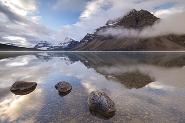 Mirror still Bow Lake at dawn on the Icefields Parkway, Banff National Park, UNESCO World Heritage Site, Canadian Rockies, Alberta, Canada, North America