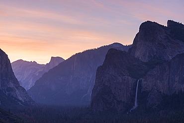 Bridalveil Falls and Half Dome at sunrise from Tunnel View, Yosemite Valley, UNESCO World Heritage Site, California, United States of America, North America