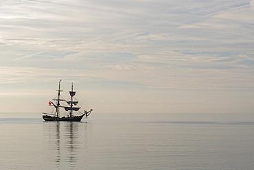 Period wooden sailing ship off the Cornish coast, Cornwall, England, United Kingdom, Europe