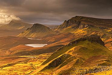 Dramatic light over the Trotternish mountain ridge from the Quiraing, Isle of Skye, Inner Hebrides, Scotland, United Kingdom, Europe