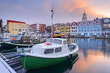 Boats moored in Torshavn harbour at sunrise, Faroe Islands, Denmark, Europe