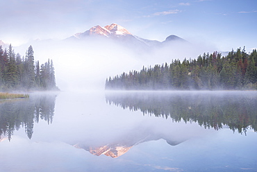 A mist shrouded Pyramid Mountain reflected in Pyramid Lake at dawn, Jasper National Park, UNESCO World Heritage Site, Alberta, Rocky Mountains, Canada, North America