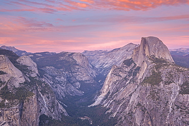 Beautiful pink sunset above Half Dome and Yosemite Valley, viewed from Glacier Point, Yosemite National Park, UNESCO World Heritage Site, California, United States of America, North America