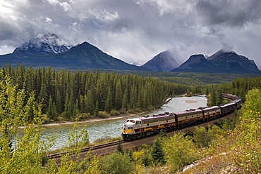 Canadian Pacific passenger train at Morant's Curve in Banff National Park, UNESCO World Heritage Site, Alberta, Rocky Mountains, Canada, North America