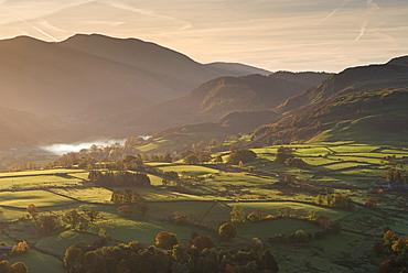 Sunlit rolling countryside near Keswick, Lake District National Park, Cumbria, England, United Kingdom, Europe
