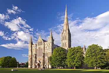 Evening sunshine glows on the ornate facade of Salisbury Cathedral, Salisbury, Wiltshire, England, United Kingdom, Europe