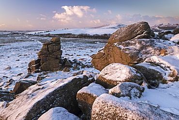 Snow dusted granite outcrops on Hound Tor, Dartmoor National Park, Devon, England, United Kingdom, Europe