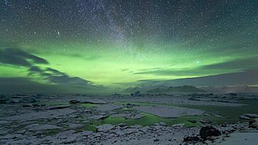 Aurora Borealis (Northern Lights) and Milky Way in the night sky above Jokulsarlon glacial lagoon, Iceland, Polar Regions