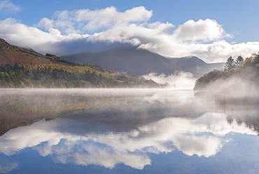 Morning mist and autumnal reflections at Loweswater in the Lake District National Park, Cumbria, England, United Kingdom, Europe