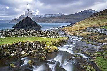 Traditional Faroese wooden turf roofed church in the village of Funningur, Eysturoy, Faroe Islands, Denmark, Europe