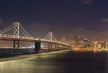 Night time cityscape of Oakland Bay Bridge and downtown San Francisco, California, United States of America, North America