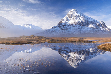 Snow covered Buachaille Etive Beag mountain reflected in a mirror still pool in winter, Rannoch Moor, Highlands, Scotland, United Kingdom, Europe