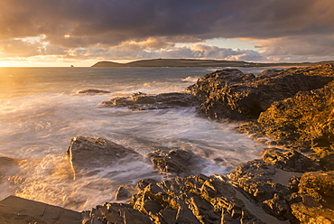 Golden evening light bathes the rocky shores near Constantine Bay in North Cornwall, England, United Kingdom, Europe