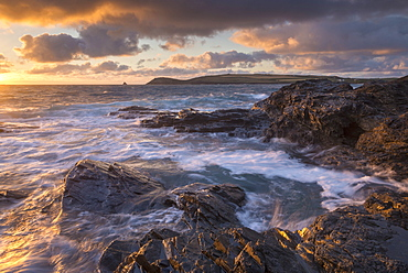 Waves crash against the rocky shores of Constantine Bay, looking towards Trevose Head, Cornwall, England, United Kingdom, Europe