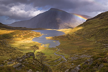 Rainbow passing over Cwm Idwal in the mountains of Snowdonia National Park, North Wales, United Kingdom, Europe