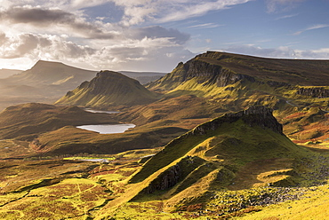 Morning sunlight on the Trotternish Mountains from the Quiraing, Isle of Skye, Inner Hebrides, Scotland, United Kingdom, Europe