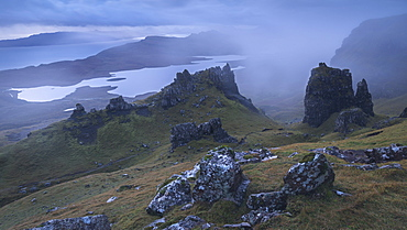 Jagged basalt peaks near the Old Man of Storr on a foggy autumn morning, Isle of Skye, Inner Hebrides, Scotland, United Kingdom, Europe