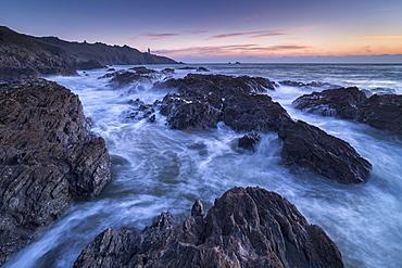 Waves swirl around the jagged rocks off Start Point in winter, South Hams, Devon, England, United Kingdom, Europe