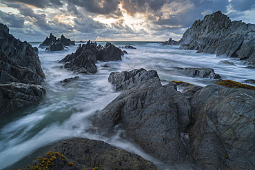 Stormy sunset over the dramatic North Devon coast, Devon, England, United Kingdom, Europe