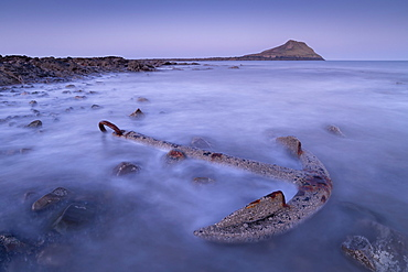 Rusted anchor from a shipwreck near Worm's Head on the Gower, Wales, United Kingdom, Europe