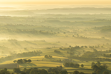 Mist covered rolling countryside at dawn, Abergavenny, Wales, United Kingdom, Europe