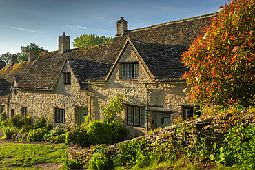 Idyllic cottages in Arlington Row in the pretty Cotswolds village of Bibury, Gloucestershire, England, United Kingdom, Europe